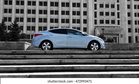 Blue car korean on black building stairs