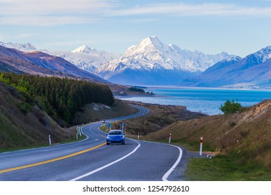 Blue car road trip with Aoraki Mount Cook in New Zealand