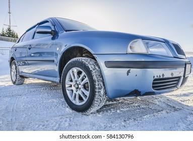 Blue car in shabby bumper