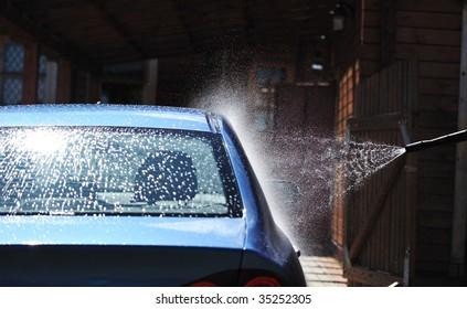 Blue car washing on open air