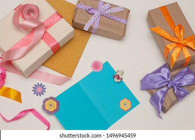 blue card paper and beautiful gifts on a fucking background Thanksgiving, birthday, mother's day, copy space,paper flowers,ribbon and bows decor
