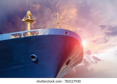 blue cargo ship close up forward on blue sky background