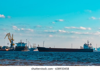 Blue cargo ship moving to the cargo port