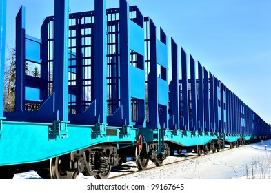 blue cargo train on the move in winter