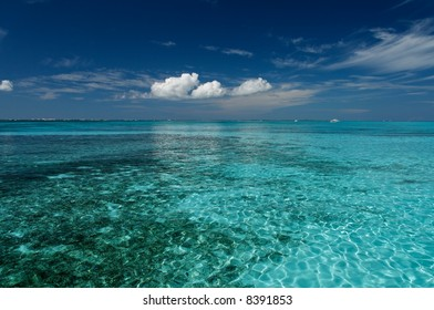 Blue caribbean water on a sand bank
