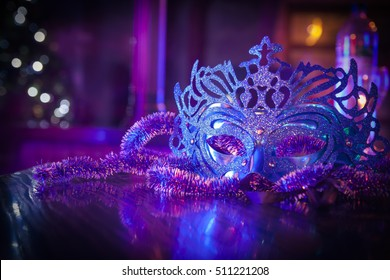 Blue carnival masquerade mask in the dark room. New Year. Venetian mask