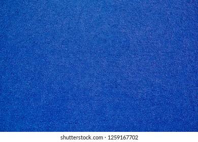 blue carpet background, blue fabric texture background, closeup