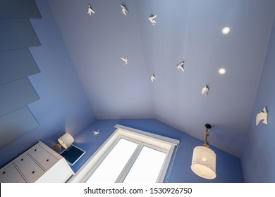 blue ceiling with seagulls in Modern apartment interior design,  small and cozy bed room