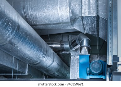 Blue centrifugal fan with huge industrial ductworks