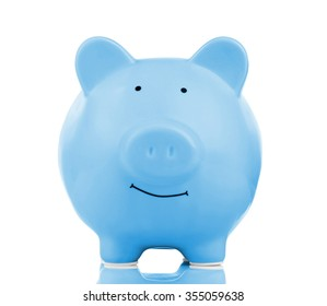 Blue ceramic piggy bank isolated on white