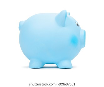 Blue ceramic piggy bank, isolated on white background. Bank savings, economy, financials investments, saving to buy a house, a car, for retirement concept.