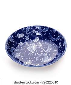 Blue ceramic plate on white background