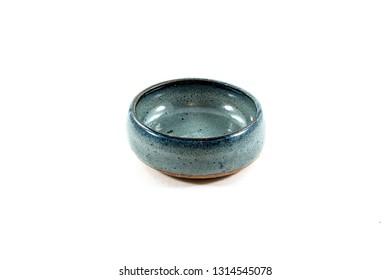Blue ceramic sauce bowl.  Artisanal craft pottery - isolated