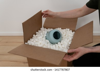 Blue Ceramic Vase Protected for Shipping with Biodegradable Packing Peanuts