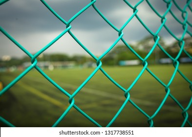 Blue Chain Link Fence at Singapore Sports Field.