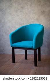 Blue chair against a gray wall. Interior