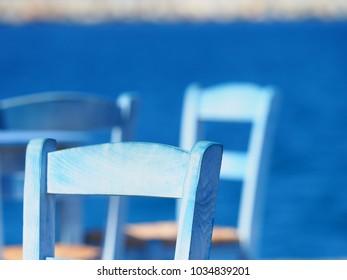 Blue chair in the sun in Santorini