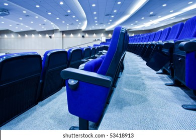 Blue chairs rows in conference hall