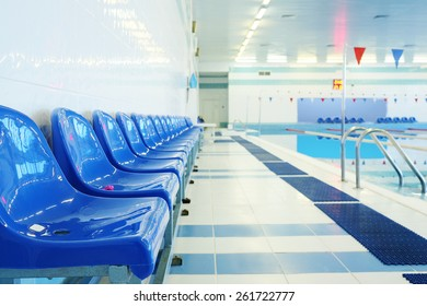 Blue chairs at the swimming pool