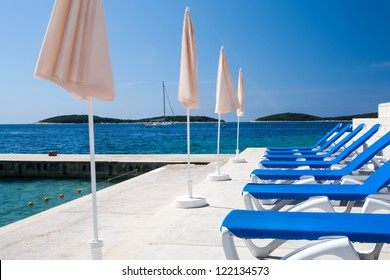 Blue chairs for the tourist to lay on in the sun.