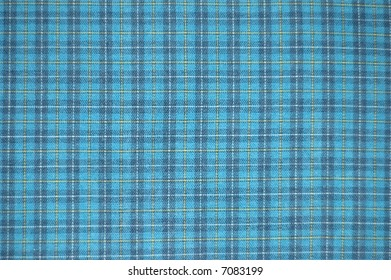 Blue checked material with yellow and white lines running through the polyester cotton fabric texture