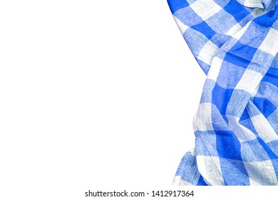 Blue checkered kitchen table picnic cloth isolated on empty copy space white background.