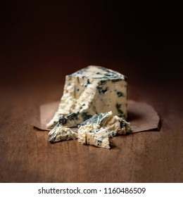 Blue cheese Gorgonzola on a rustic wooden background. Mold cheese with copyspace