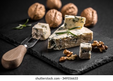 Blue cheese with nut on black slate