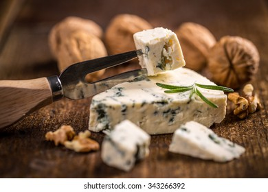 Blue cheese on vintage wooden background