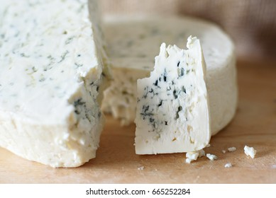 Blue cheese on wooden Board