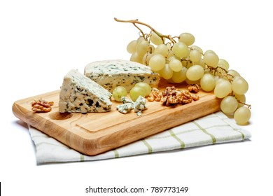 blue cheese on wooden cutting board