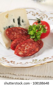Blue cheese and slices of spicy sausage