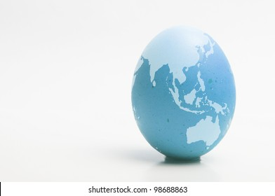 blue chicken egg with image of Australia and Asia printed
