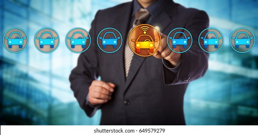 Blue chip automobile designer selecting a connected auto in a lineup. Concept for autonomous or driverless car, vehicle tracking system, artificial intelligence and vehicular communication systems.