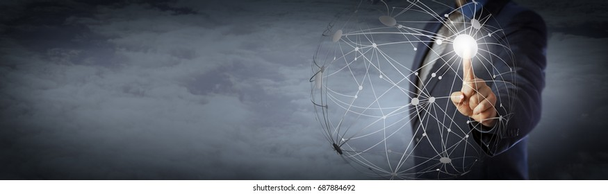 Blue chip manager activating a globe shape network high above the clouds. Information technology concept for global communications, computer network and remote access. Copy space on panoramic banner.