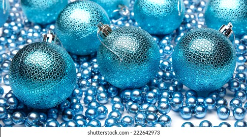 blue christmas ball and beads, closeup