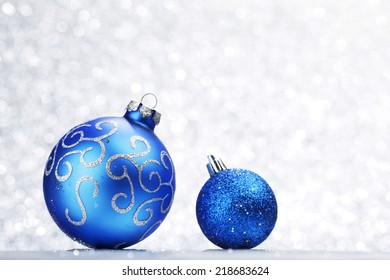 Blue Christmas balls on abstract glitter silver background