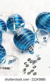 blue christmas balls on white snow