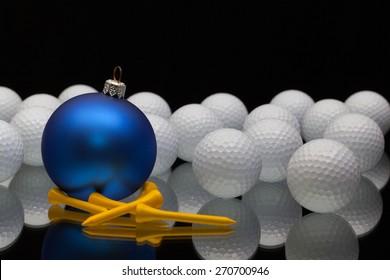 Blue Christmas decoration a golf balls on a black glass desk