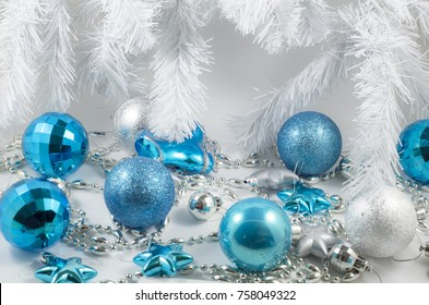 blue christmas decorations on a white background
