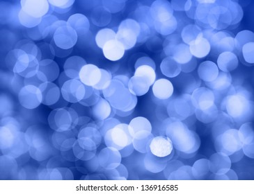 Blue Christmas lights at night. Beautiful blurred background.