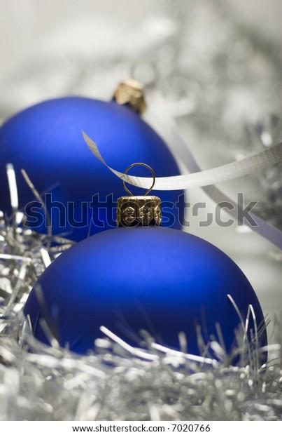 blue christmas ornaments with ribbon close up shoot