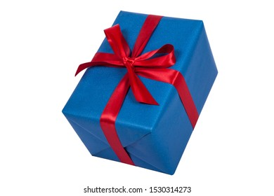 Blue christmas present with red ribbon on white