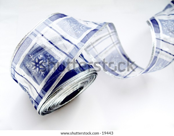 Blue Christmas ribbon isolated on white background