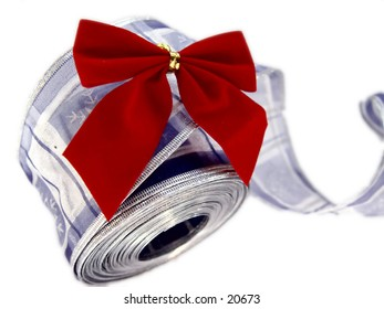 Blue christmas ribbon and red bow, isolated on white background