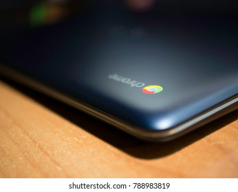 Blue Chromebook on a wooden table