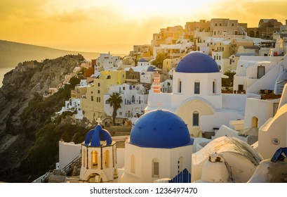 Blue church with cityscape of Santorini, Greece. Santorini is one of the most popular islands for destination weddings and honeymoons.