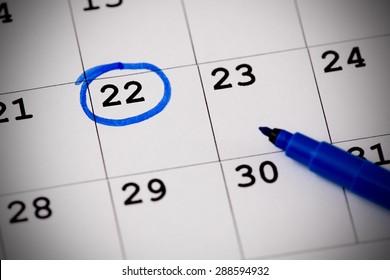 Blue circle. Mark on the calendar at 22.