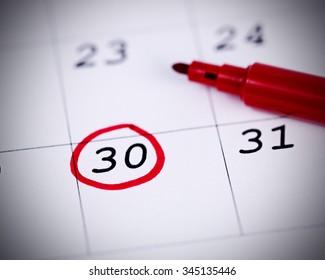 Blue circle. Mark on the calendar at 30.