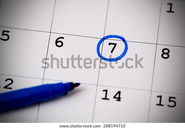 Blue circle. Mark on the calendar at 7.